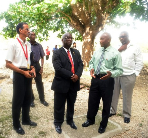 From left, project manager with the Ministry's Education Project Implementation Unit Richard Harrison, senior draughtsman at the Ministry of Education Andrew Parris, Minister of Education Ronald Jones, Combermere principal Vere Parris and Parlimentary Secretary Harry Husbands during a site tour of Combermere.