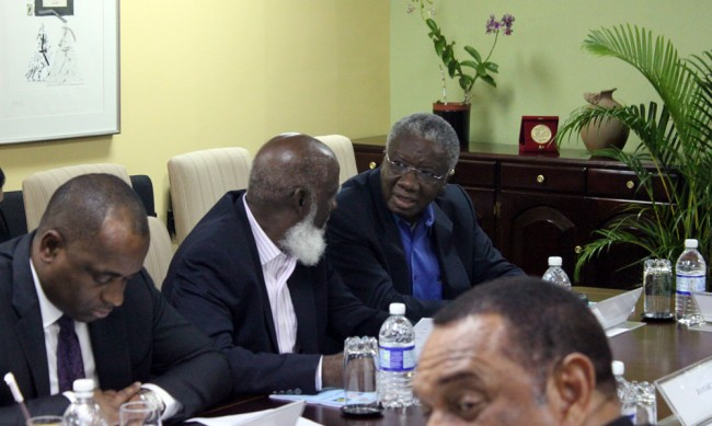 Leaders like Prime Minister Freundel Stuart (right) and his Dominica counterpart Roosevelt Skerritt (left) have been advised to be careful of strings attached to foreign aid. Here, Stuart is in discussion with Attorney General and Minister of Foreign Affairs in Belize Wilfred Elrington (centre) at the CARICOM Heads Caucus last night,         ahead of the meeting with US President Barack Obama today.