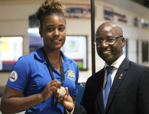 Gold medal winner in the javelin Hayley Matthews sharing the spotlight with Minister of Sports Stephen Lashley.