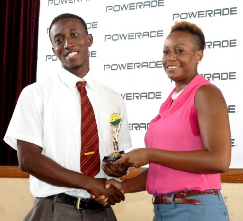 Mario Burke received his trophy for breaking the under-20 boys 100m record.