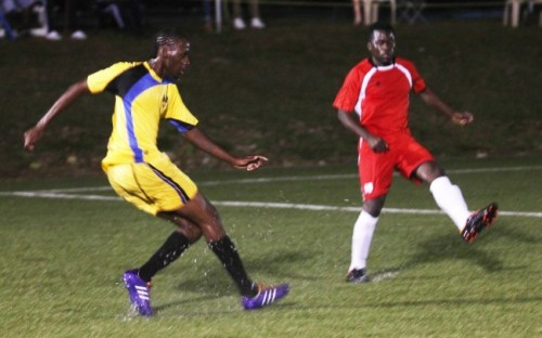 UWI striker Dario Harewood (left) scored two goals for his team against Sunrise.