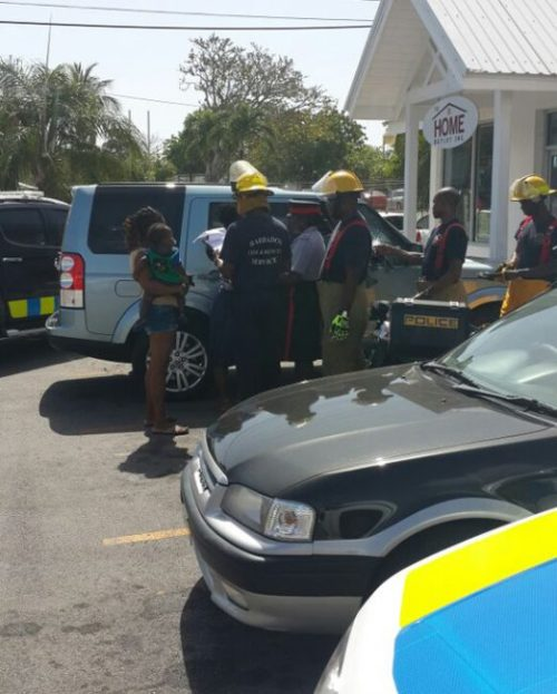 Lawmen and fire officers on the scene at Kingsland, Christ Church where Zakara Watson was rescued.