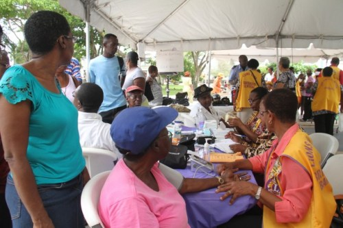 For World Health Day 2015, the International Association of Lions Clubs hosted the Annual Zone Health Fair in Independence Square earlier today. Under the theme Food Safety: From Farm  To Plate, Make Food Safe, organizations offered demonstrations and gave talks. Members  of the public were also given free immunizations,  as seen here, a new addition to the fair.