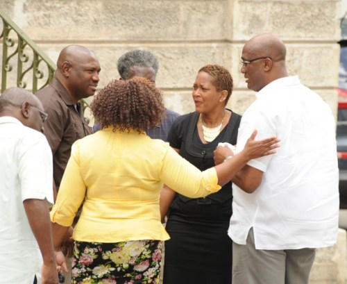 Today the Nation newspaper's Managing Editor Tim Slinger (right) was surrounded by colleagues as he appeared in court.