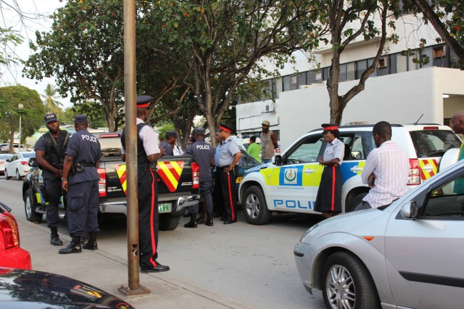 Police outside the Queen Elizabeth Hospital yesterday.