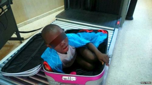 An eight-year-old boy seen cramped inside  a suitcase on a Spanish civil guard border security checkpoint between Morocco and Spain's North African enclave of Ceuta today. Inset, the X-ray image of the suitcase.