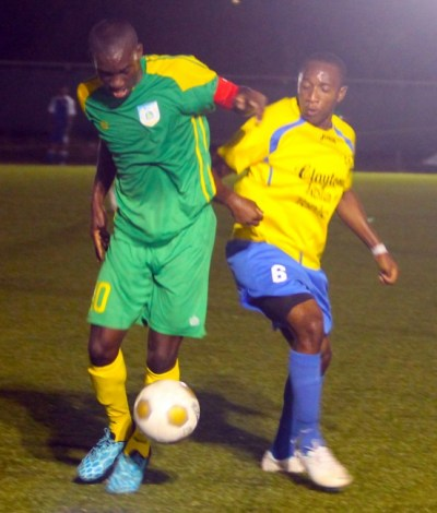 BDFSP captain and goal-scorer  Romario Harewood (left)being challenged by Renaldo Gilkes of Notre Dame.