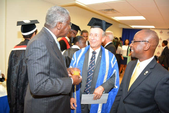 Prime Minister Freundel Stuart in conversation with businessman Paul Altman and Minister of Culture, Sports and Youth, Stephen Lashley.