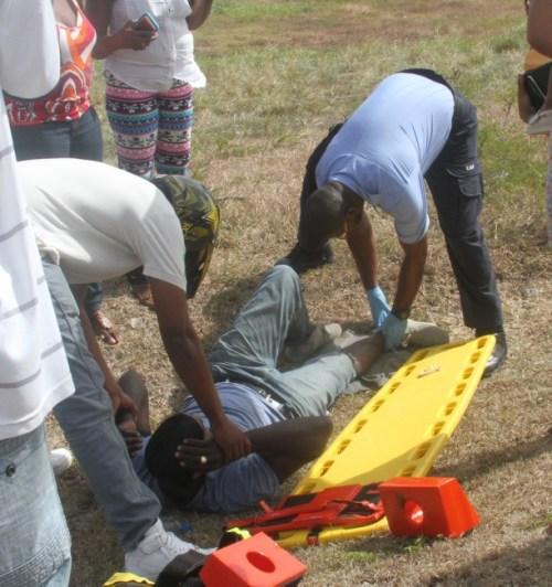 Emergency personnel tending to Kerwyn Husbands at the scene.