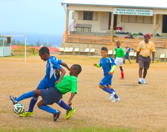 Jelano Jones of St Christopher tackled Aiden Alleyne of St Gabriel's from behind.