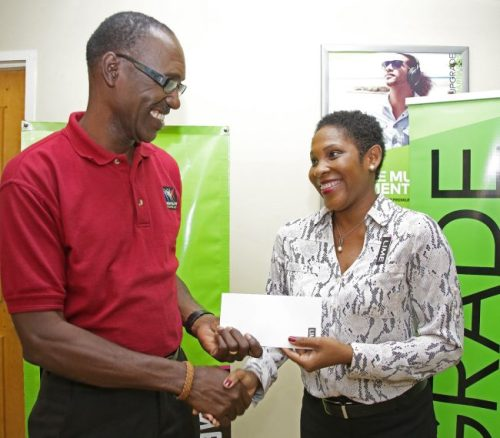 LIME's corporate communications and public relations manager Marilyn Sealy (right), presenting Gospelfest producer Adrian Agard with a sponsorship cheque.