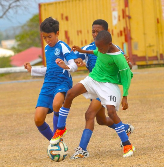 Neil Marquez (left) of St Gabriel's School tried to challenge Kaleel Waithe of St Christopher Primary for ball possession.