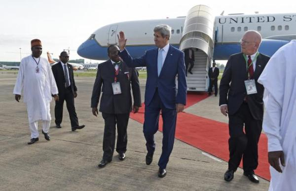 Secretary of State John Kerry waving as he arrives at Nnamdi Azikiwe International Airport in Abuja, Nigeria, yesterday.