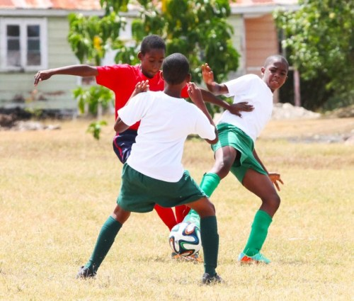 St Cyprian's goal scorers Nathaniel Rudder and Jaden Sealy teamed up to take possession away from Khalil Vanderpool of Charles F. Broome.