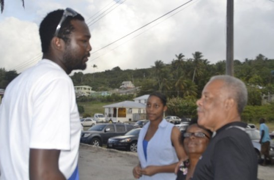 West Indies spin bowler Sulieman Benn in conversation with former Prime Minister Owen Arthur, as Arthur's daughter looks on.