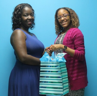 BT Account Executive Tamesha Doughty presenting Shanice Sealy with prize.