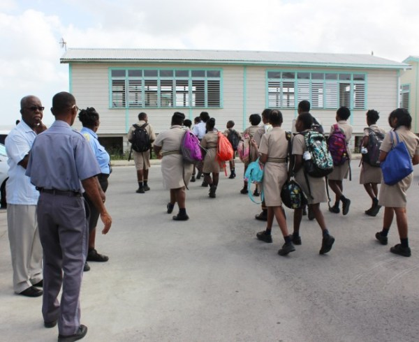 Combermere students entering the entrance gate of SJPP this morning.