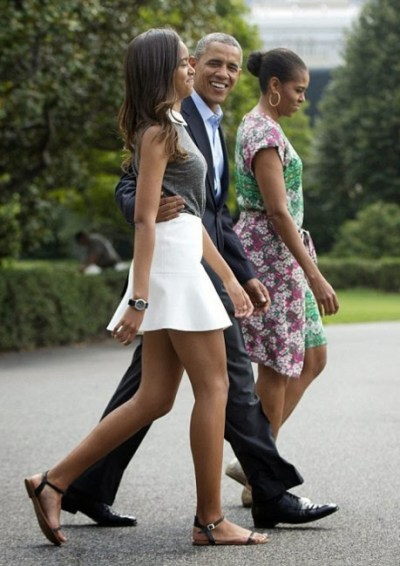 President Barack Obama (centre) with his daughter Malia and wife Michelle.