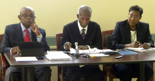 Three of the seven members of the Employment Rights Tribunal listen intently during the first hearing into the dismissal of former KPMG employee Joel Leacock. From left, Ed Bushell, Chairman Hal Gollop and Beverly Beckles.