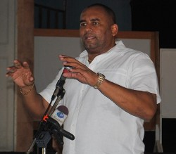 Minister of Tourism Richard Sealy addressing party members Sunday.