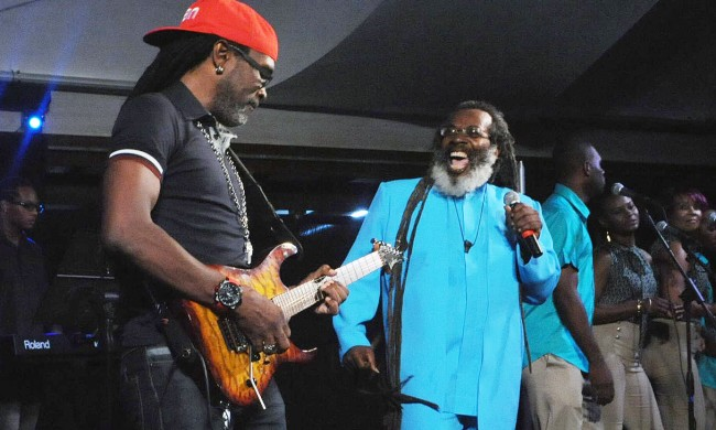 Adonijah singing the Blues as Ian Alleyne (left) accompanies.