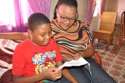 Amal Blackman and mother Keisha viewing his commendable 11-Plus results.