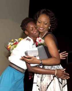 4th Form Student Jonelle King embracing Featured Speaker Kaymar Jordan.