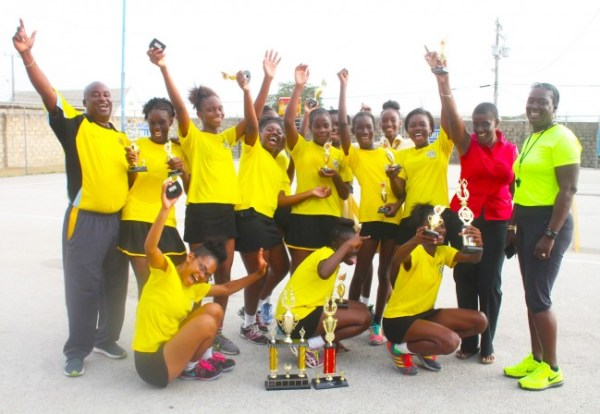 Foundation netball queens and trainers celebrate.