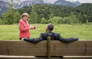 German Chancellor Angela Merkel speaking with President Barack Obama outside the Elmau castle in Kruen near Garmisch-Partenkirchen, Germany, today.