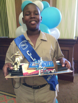 Graduand Mileek Goodman with his prizes.