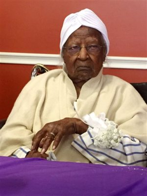 In this Thursday, May 21, 2015 file photo, Jeralean Talley, born on May 23, 1899, is honoured at the Inkster, Michigan district office of the Michigan Department of Health and Human Services.