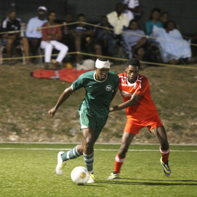 Jadai Clarke (left) tried to maintain ball possession while Cameron Lewis of Silver Sands tried to put him under pressure.