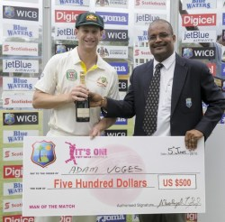 Man-of-the-Match Adam Voges receives his award from WICB vice-president Emmanuel Nanthan.