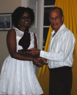 Keisha Nurse receiving her award from Gregory Adams.