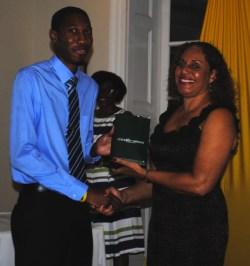 Kemar Holder receiving his award from Margaret Hoyte.