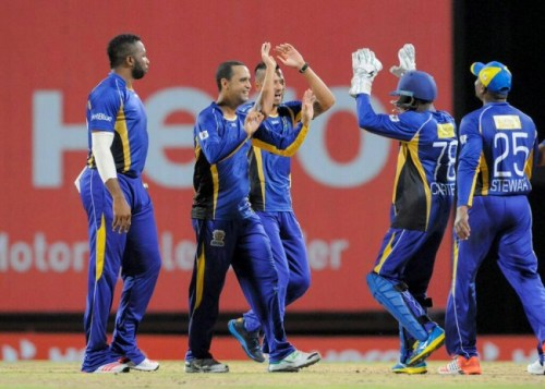 The Barbados Tridents' Robin Petersen (second left) will be hoping to continue his good bowling form when they take on the Trinidad and Tobago Red Steel tomorrow.