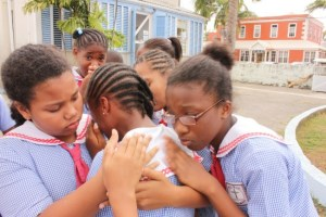 The Rock Christian School was in the top ten performing schools in this year's 11-Plus examination. Here some of the children console one of their peers  as she broke down in tears.