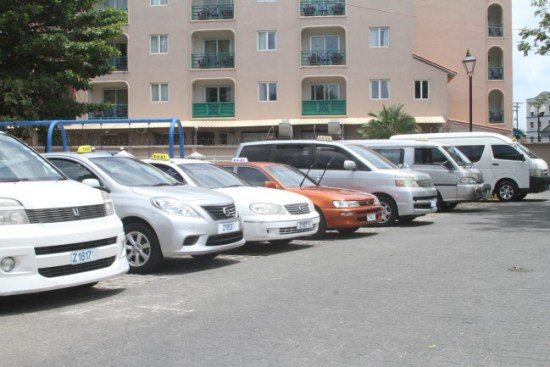 Some of the taxis at the Accra taxi stand awaiting passengers.