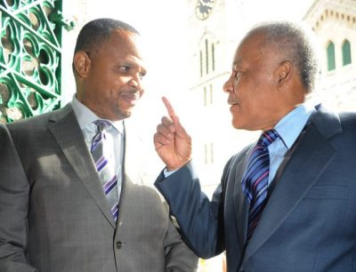 Former prime minister Owen Arthur speaking to Minister of Finance, Chris Sinckler last week.