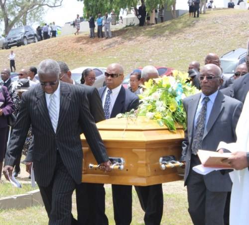 Prime Minister Freundel Stuart leading pallbearers carrying his sister's casket  to her final resting place.