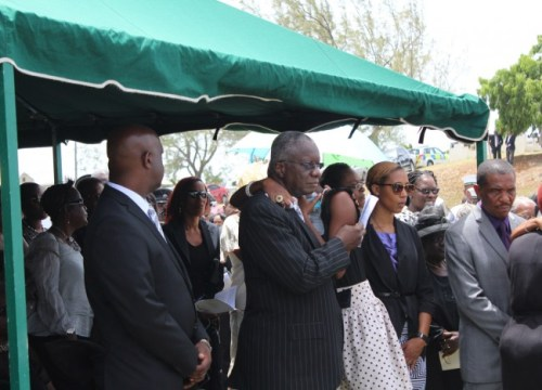 Prime Minister Freundel  Stuart consoling his daughter  Julienne St Hill at the burial.