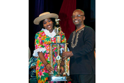 Reigning Junior Calypso Sammy G accepting her award from Minister of Culture Stephen Lashley last year.