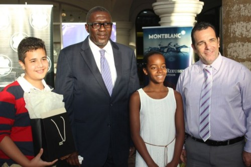 Top students Micah Williams (left) of People's Cathedral and Jazmine Simmons (second from right) of St Angela's posing with Acting Minister of Education Senator Harcourt Husbands (second from left) and Managing Director of Diamonds International Jacob Hassid (left).