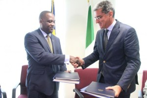 Let's shake on it Minister of International Business Donville Inniss  (left) and Italy's Ambassador  to Barbados Paolo Serpi seal  the deal with a handshake  after signing the Double Taxation Agreement.   (Picture by Amory Alleyne)