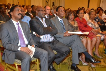 Attorneys General Basil Williams of Guyana (left) and Adriel Brathwaite ofBarbados (second left) with Sir Richard Cheltenham (third from left) and wife  at the Dr Lloyd Barnett Lecture.