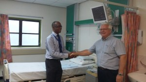Consultant neurosurgeon Dr John Gill (left) thanking trustee of the John Thompson Memorial Trust Fund Ronald Jones for the refurbished SICU.