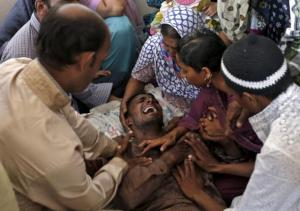 A Muslim man (centre) weepsing after getting the news of his family members, who died in yesterday's stampede in Mina, at their residence in Ahmedabad, India, today.