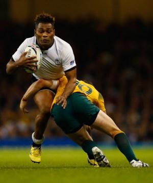 Australia's Bernard Foley tackles Fiji's Metuisela Talebula (with ball).
