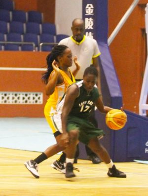 Cavaliers shooting guard Maria Cumberbatch goes around Jada Saunders of UWI. (Pictures by Morissa Lindsay).