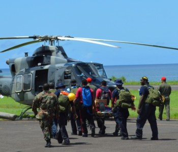 Rescue teams leaving Canefield Airport via helicopter.